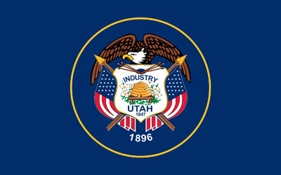 The Utah flag featuring the industrial symbol, the beehive. Image via Wikimedia commons.