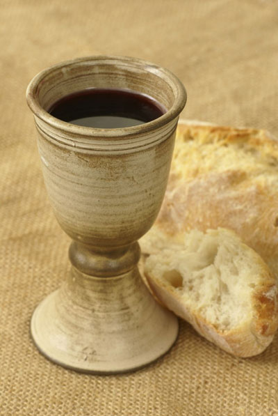 The deep red wine that comes from grapes strongly symbolizes the blood of Jesus Christ in the administration of the sacrament. image via oneclimbs.com