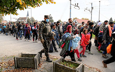 Syrian migrants and refugees pass through Slovenia. Image via Wikimedia commons.