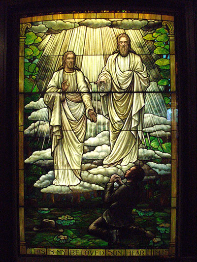 Stained glass depiction of the first vision in the Church History Museum. Image via latterdaysense.org
