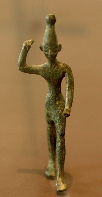 Bronze figure of the Canaanite storm god Baal. The figure would have very likely been holding a bolt of lightning in his raised hand. Image via Wikimedia commons.