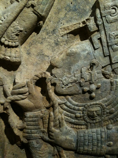 Detail from the Yaxchilan lintel depicting a bloodletting using a person's tongue.