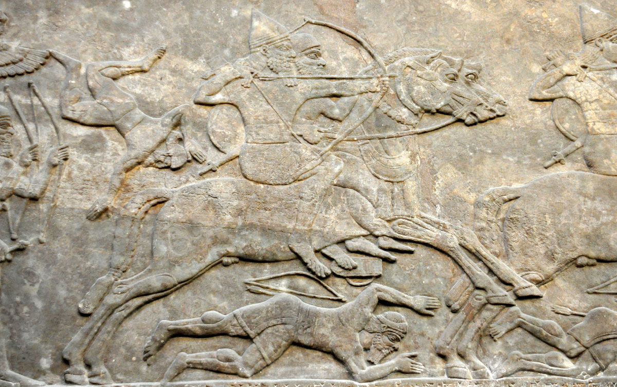 Detail of a gypsum wall relief from Nimrud, Iraq via Wikimedia Commons