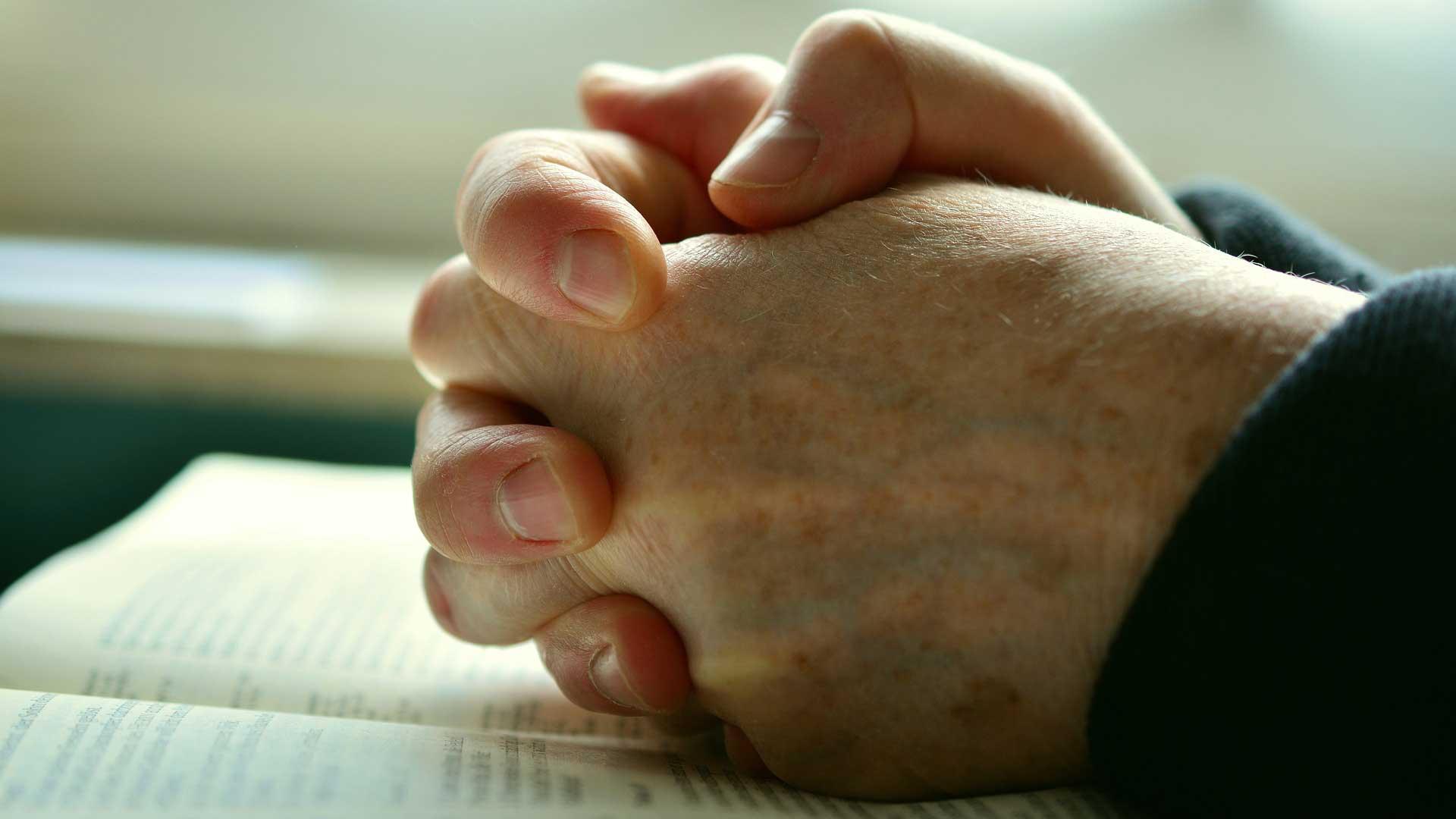 Image of praying person by congerdesign via Pixabay.