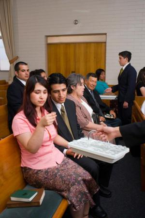 Woman partaking of the sacrament via lds.org
