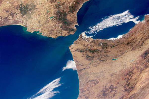 "Strait means ""narrow"", such as when connecting two large bodies of water. Satellite image of the Strait of Gibraltar via Wikimedia Commons"