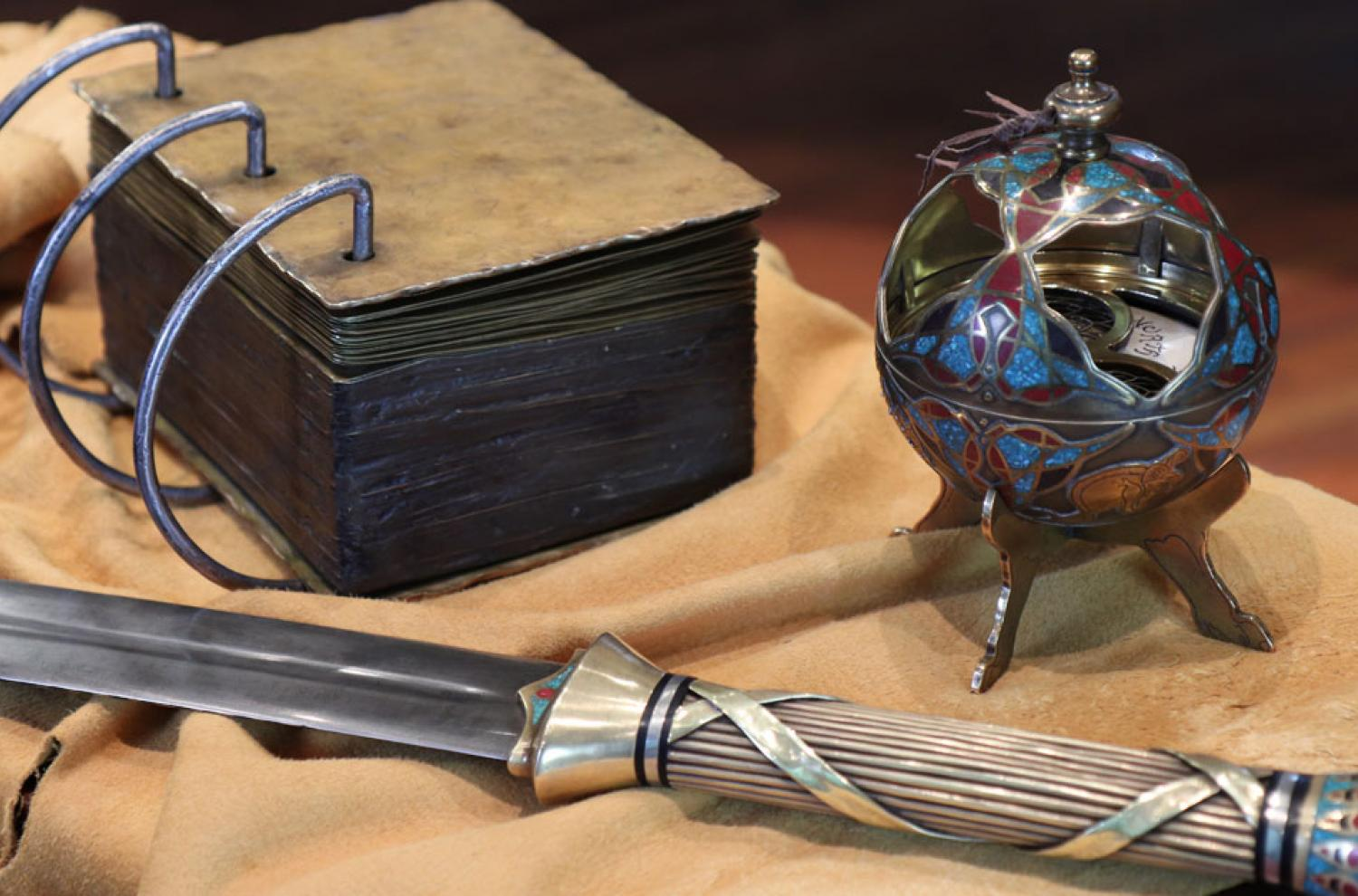 Artistic replicas of the gold plates, the sword of Laban, and the Liahona by David Baird. Photo by Daniel Smith.