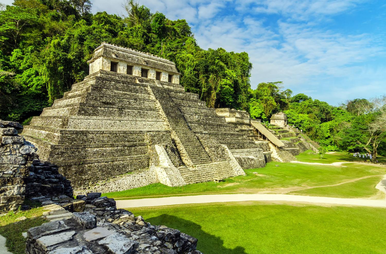 Temples in Palenque. Image via Adobe Stock.