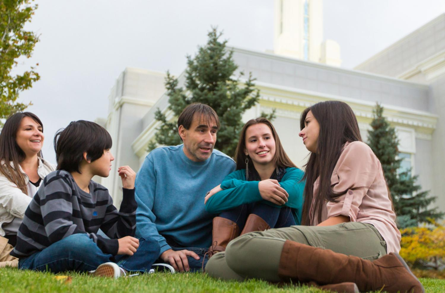 Family Sitting outside a Temple via lds.org