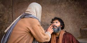 Jesus healing a blind man. Image via lds.org