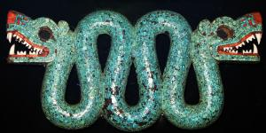 Photo of an aztec double headed serpent, turqoise chest ornament by Geni