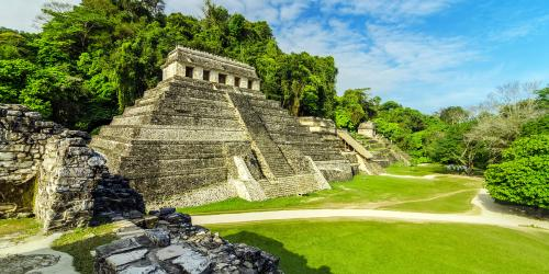 Temples in Palenque. Image via Adobe Stock.